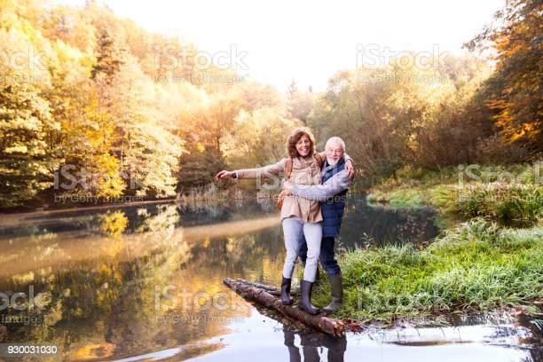 Photo of Senior couple on a walk in autumn nature.