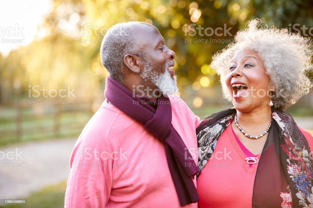 Senior Couple On Autumn Walk In Countryside Together royalty-free stock photo