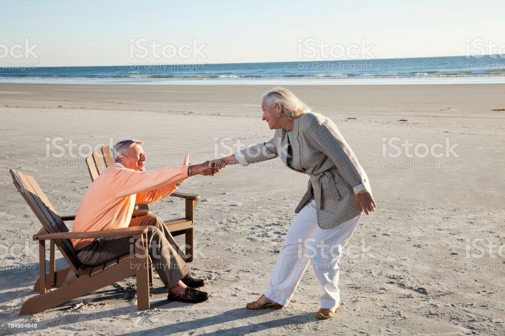Senior couple on beach royalty-free stock photo