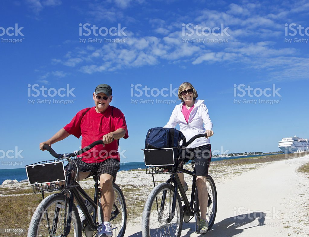 Senior Couple on bike ride while enjoying a cruise vacation stock photo