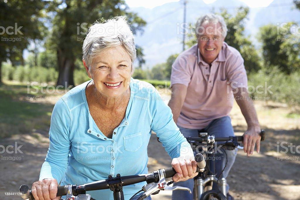 Senior couple on country bike ride - Royalty-free 60-69 Years Stock Photo