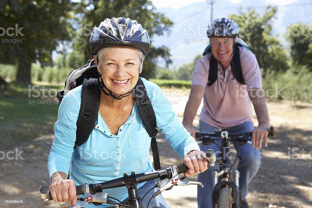 Senior couple on country bike ride stock photo