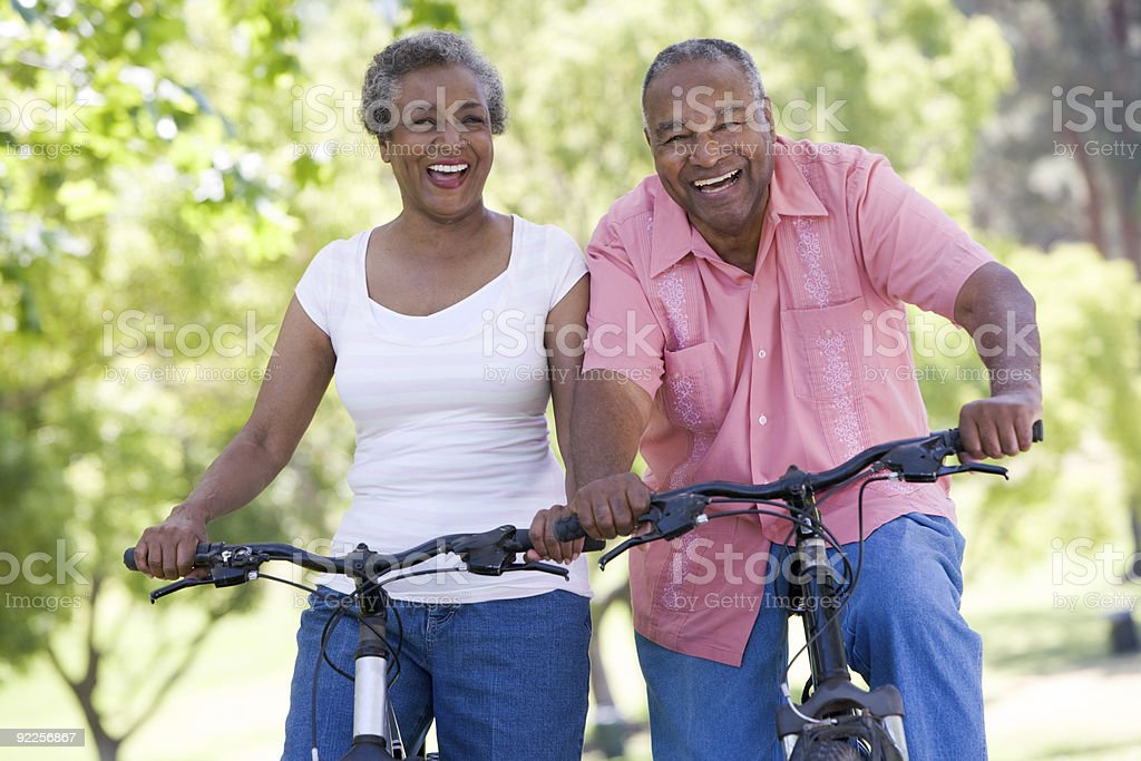 Senior couple on cycle ride Senior couple on cycle ride in countryside 70-79 Years Stock Photo