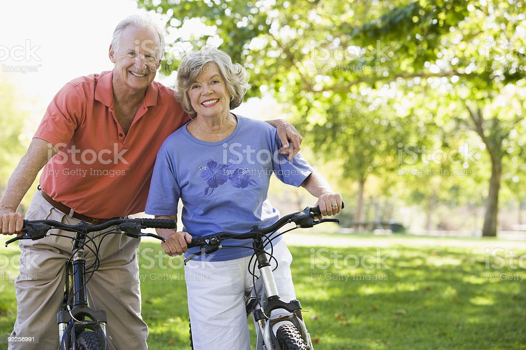 Senior couple on cycle ride stock photo
