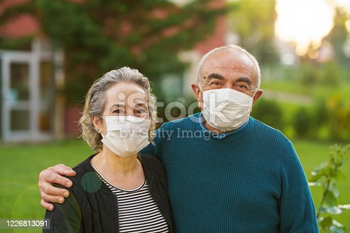 Senior couple on front of their house during COVID-19 quarantine