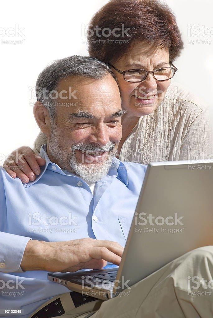 Senior couple on laptop royalty-free stock photo