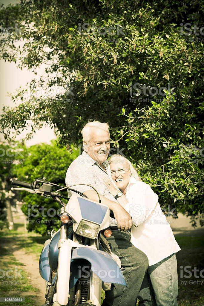 Senior couple on motorcycle ride royalty-free stock photo