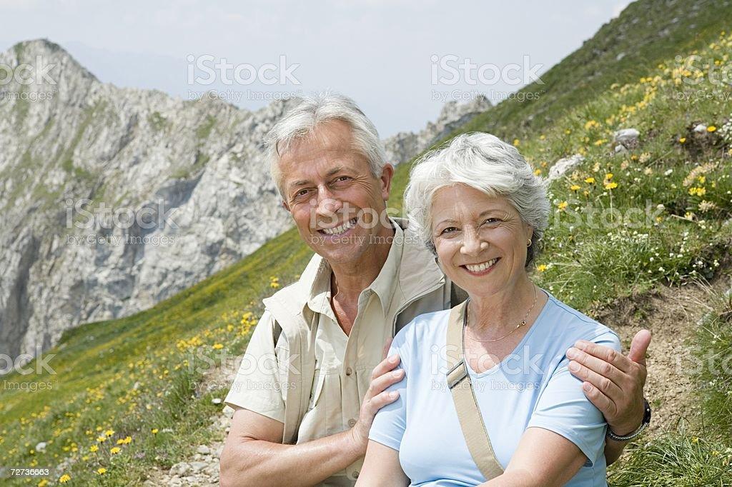 Senior couple on mountainside royalty-free stock photo