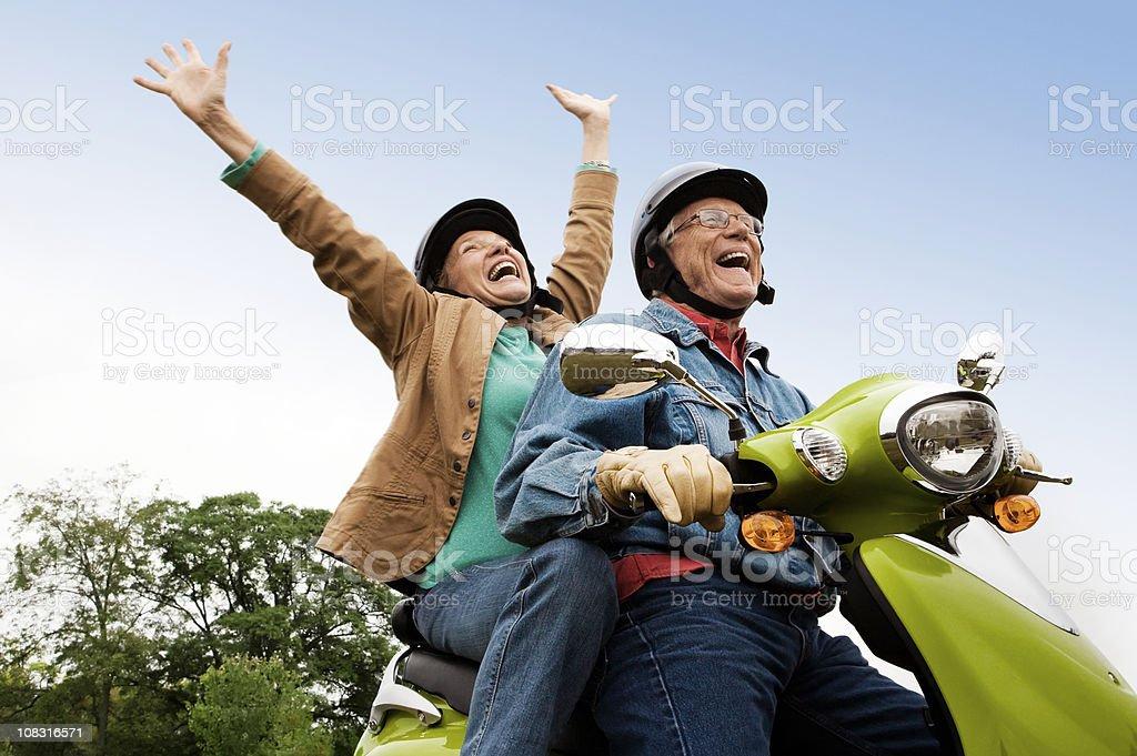 Senior Couple on Scooter royalty-free stock photo