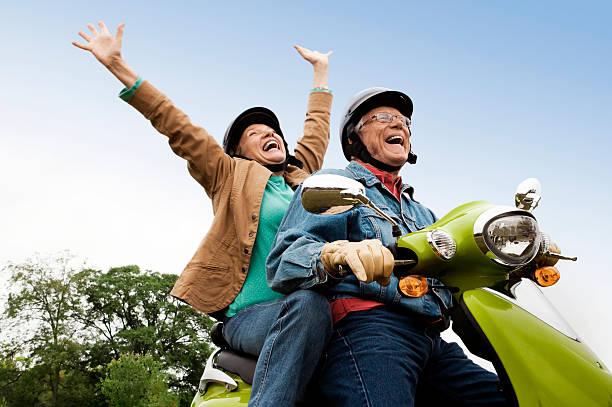 Senior Couple on Scooter stock photo