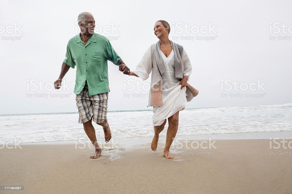 Senior couple on the beach stock photo