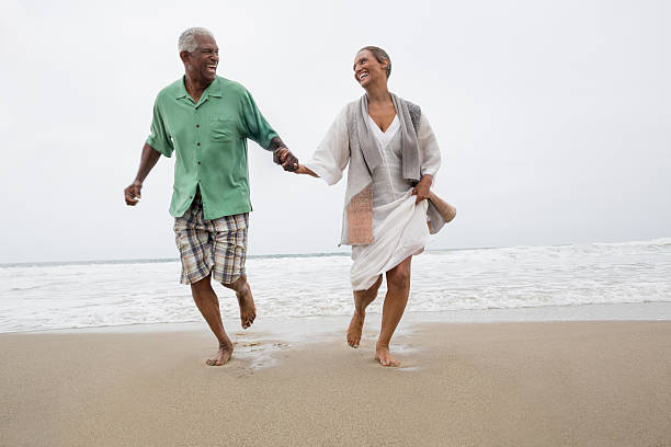 Senior couple on the beach stock photo