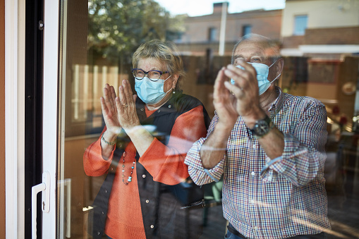 Senior Couple On Their 70s Clapping Hands At Home In Quarantine Covid19 Stock Photo - Download Image Now