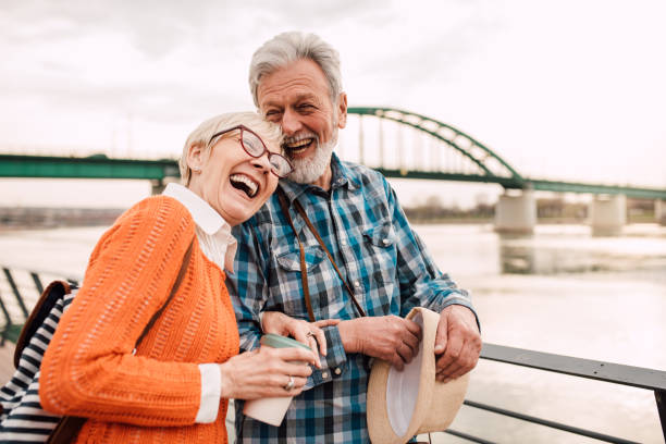 Senior couple on vacation enjoying by the river stock photo