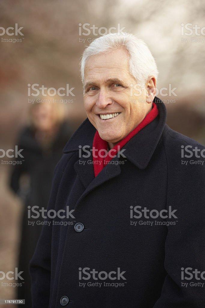 Senior Couple On Winter Walk Through Frosty Landscape royalty-free stock photo