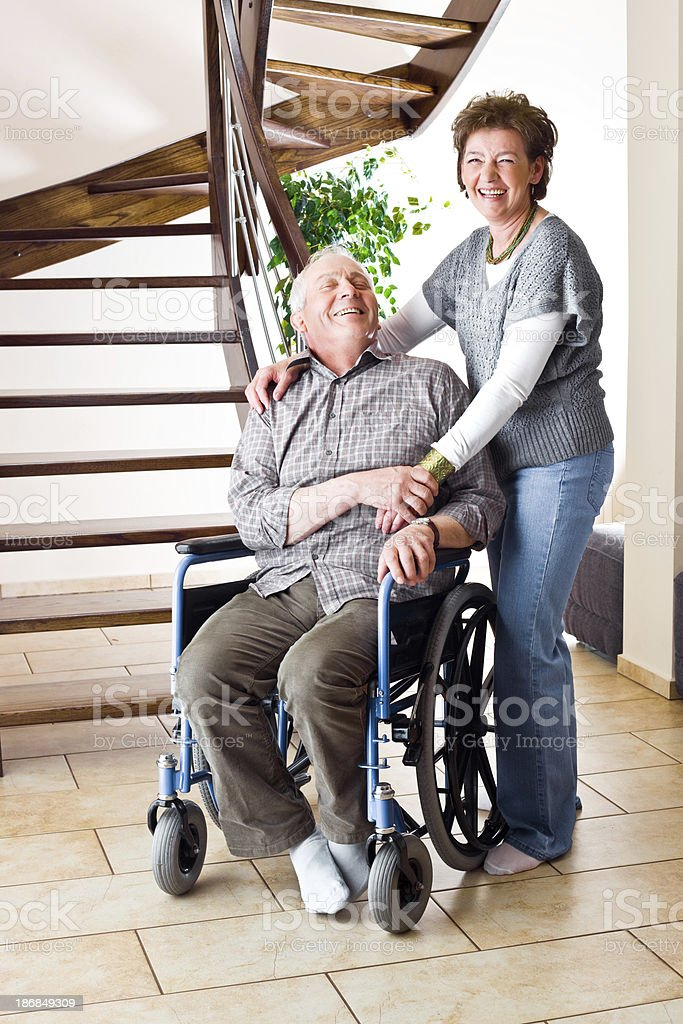 Senior couple, One In Wheelchair royalty-free stock photo