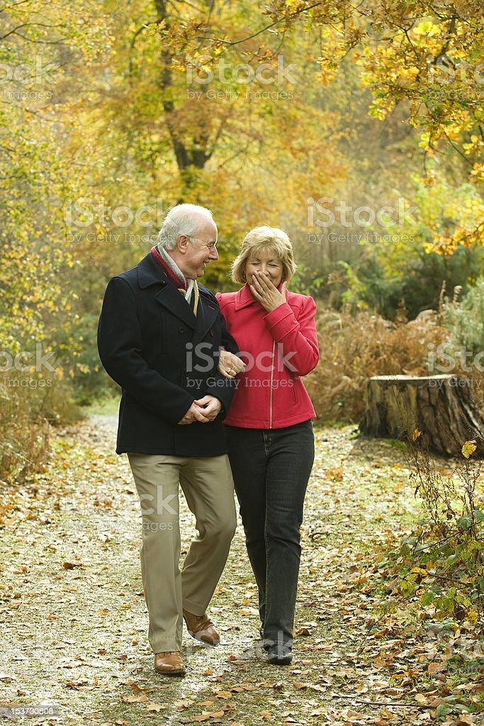 Senior Couple out for an Autumn Walk royalty-free stock photo