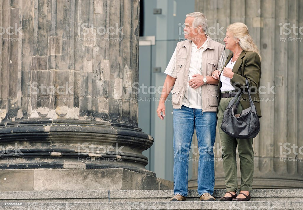 Senior couple outdoors looking at copy space stock photo