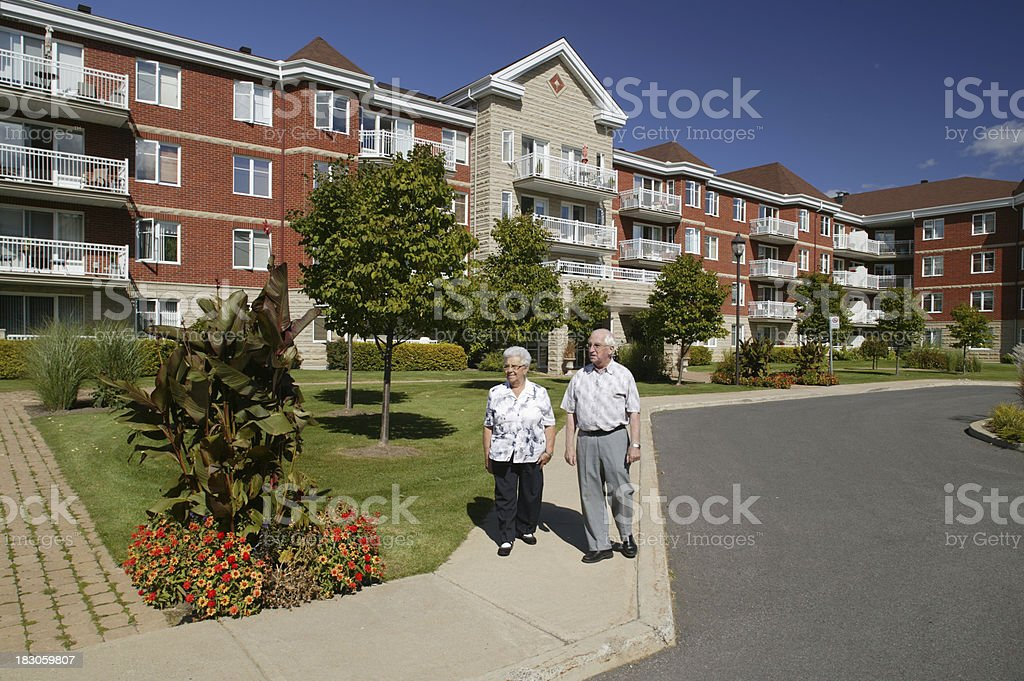 senior couple outdoors walking stock photo