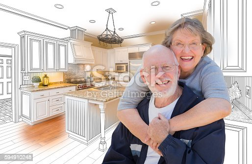 istock Senior Couple Over Custom Kitchen Design Drawing and Photo 594910248