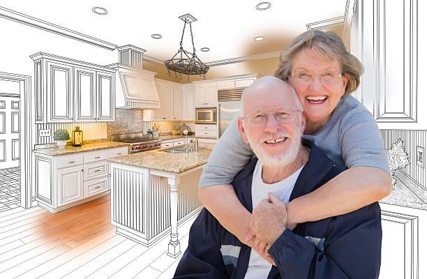senior couple over custom kitchen design drawing and photo - küche neu gestalten ideen stock-fotos und bilder