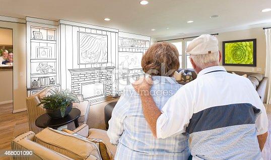 594910248istockphoto Senior Couple Over Custom Living Room Design Drawing and Photo 468001090