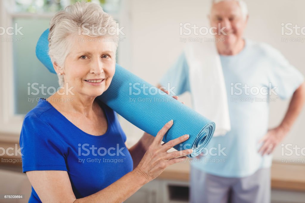 Senior couple packing up after workout royalty-free stock photo