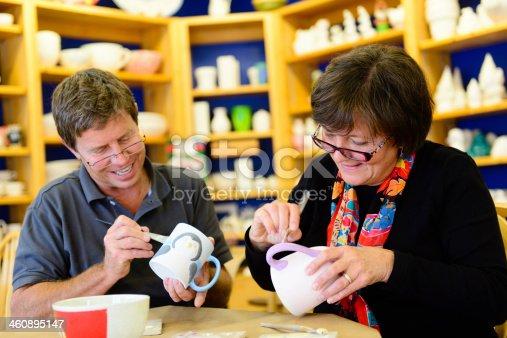 istock Senior Couple Painting Pottery 460895147