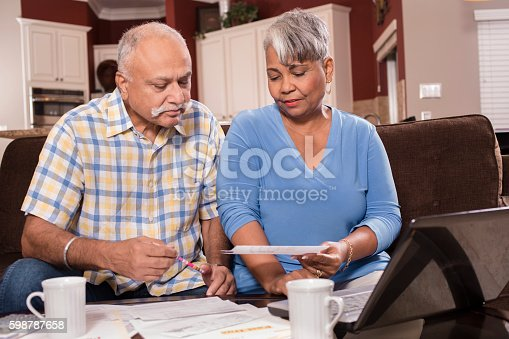 istock Senior couple paying monthly bills at home. 598787658