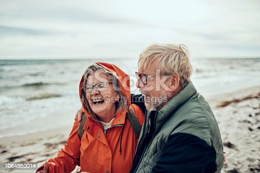 Close up of senior couple having a walk by the beach