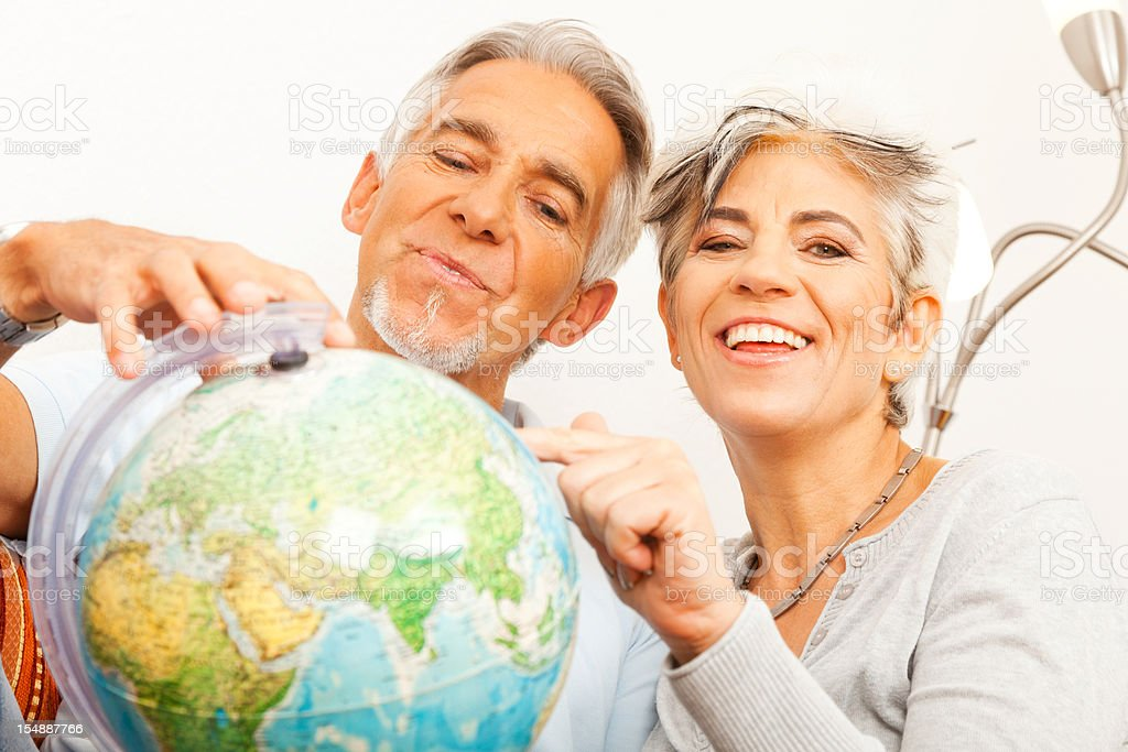 senior couple planning a world tour royalty-free stock photo