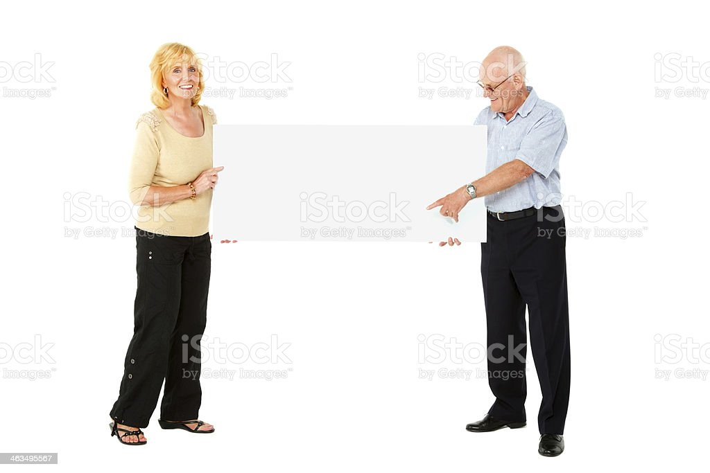 Senior Couple Pointing Blank Banner In Their Hands Stock Photo Download Image Now Istock