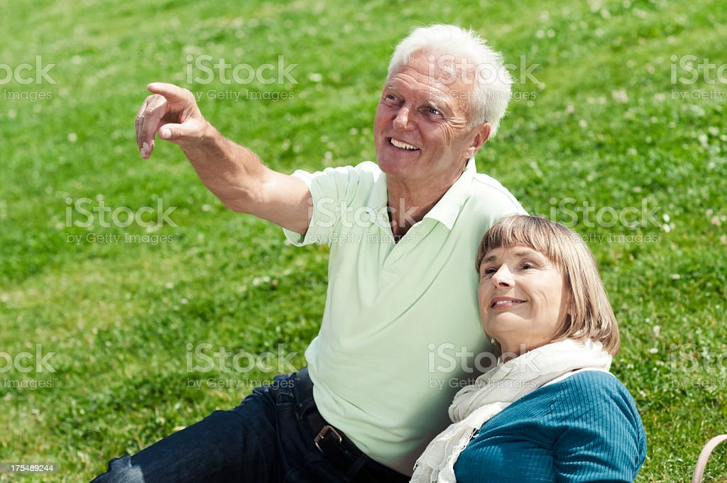 Senior couple points and looks royalty-free stock photo