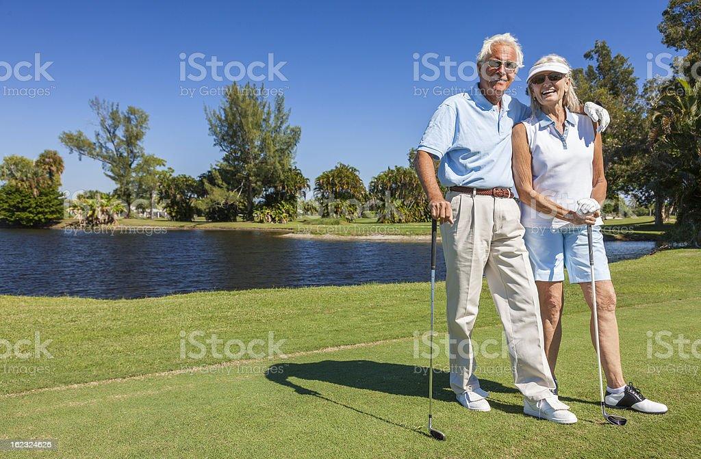 Senior couple posing at a golf range stock photo