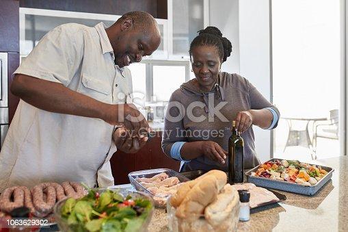 istock Senior couple preparing food at home 1063629302