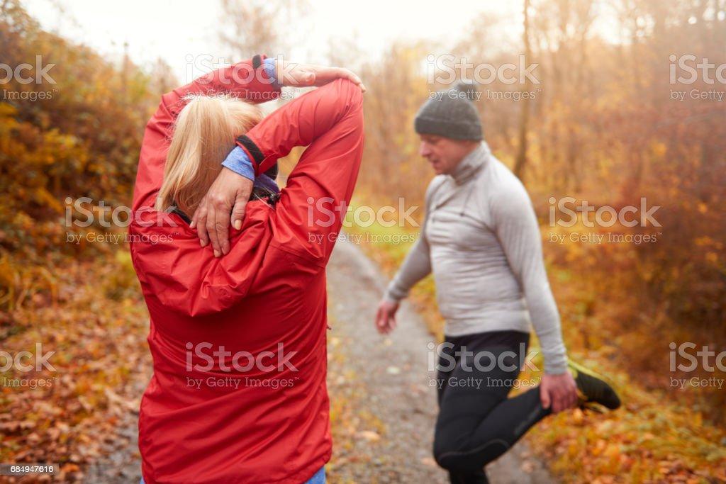 Senior couple preparing to jogging Lizenzfreies stock-foto