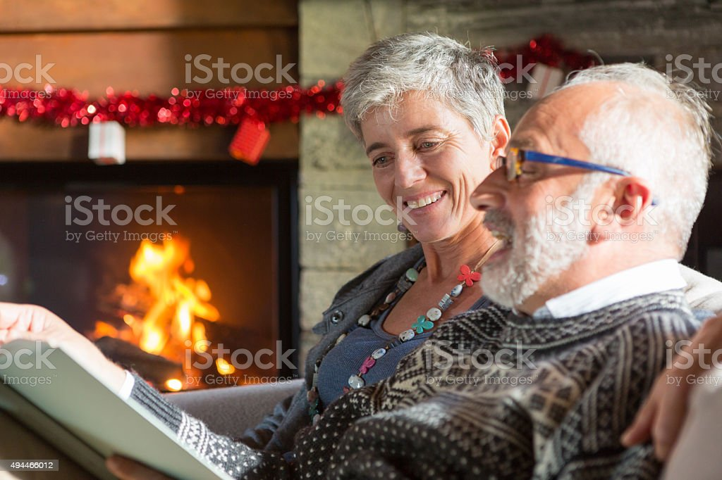 senior couple  reading a book in relaxation stock photo