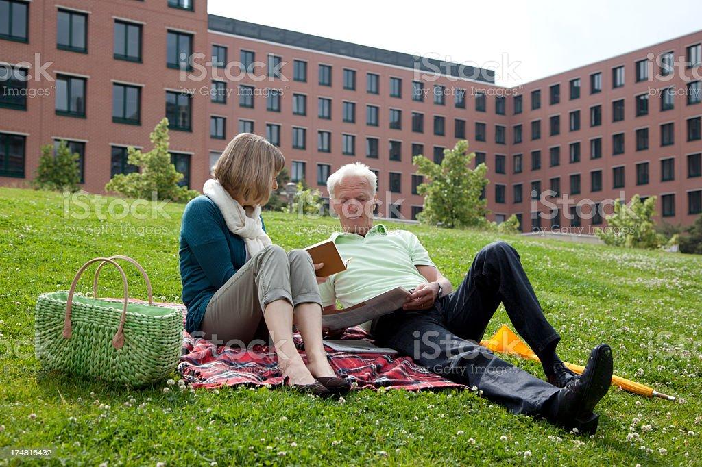 Senior couple reading in the Park royalty-free stock photo