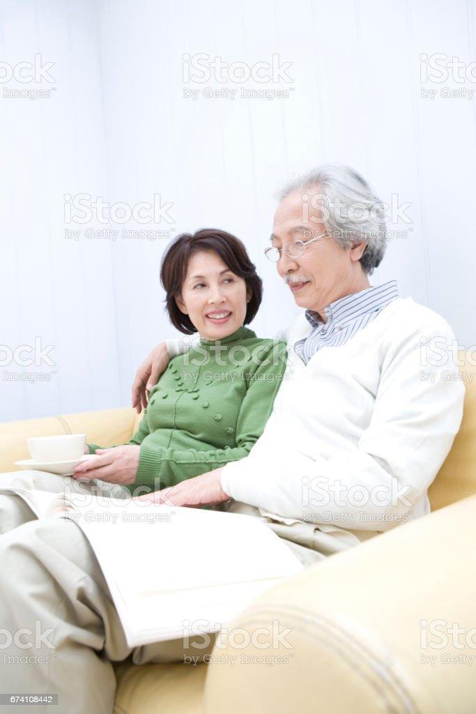 Senior couple reading magazines royalty-free stock photo