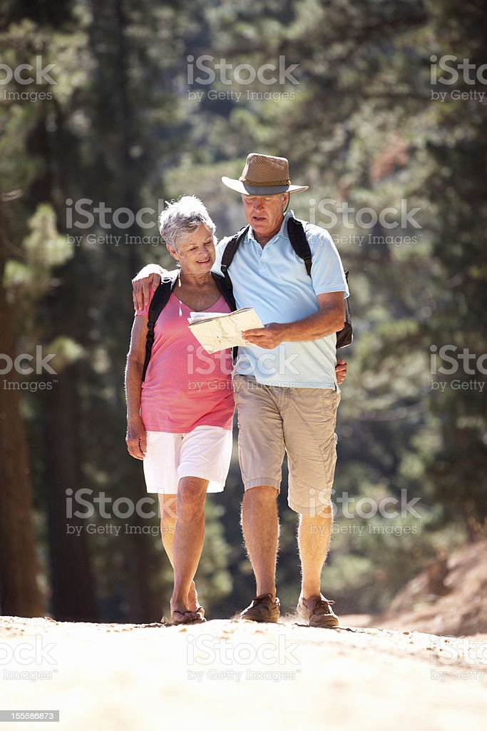 Senior couple reading map on country walk royalty-free stock photo