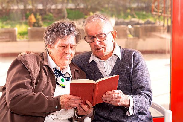 senior couple reading stock photo