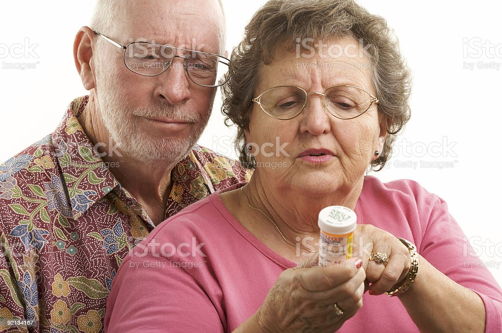 Senior Couple Reads a Prescription royalty-free stock photo
