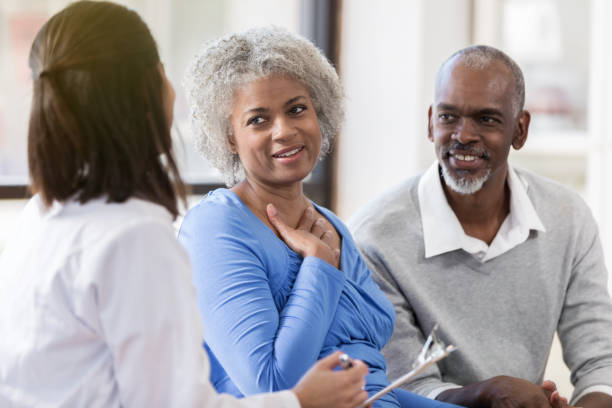 Senior couple receive good news from doctor stock photo