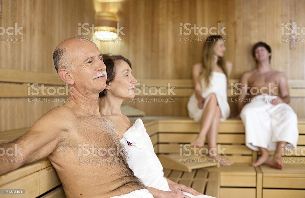Girl with old man at sauna
