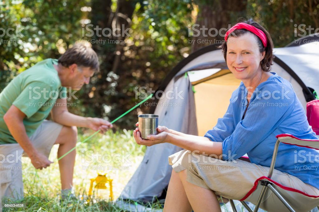 Senior couple relaxing beside their tent royalty-free stock photo