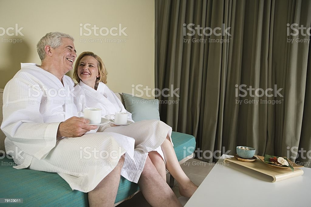Senior couple relaxing in a hotel room 免版稅 stock photo