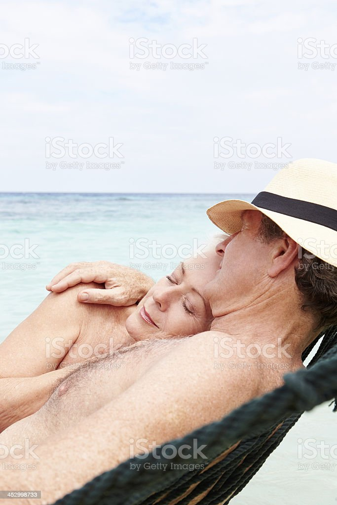 Senior Couple Relaxing In Beach Hammock royalty-free stock photo