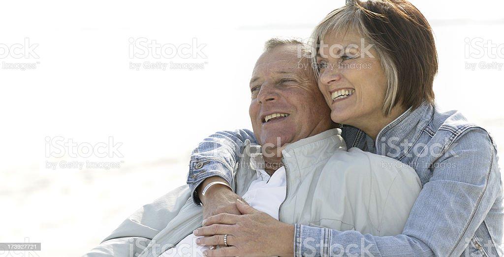 Senior couple relaxing on beach royalty-free stock photo