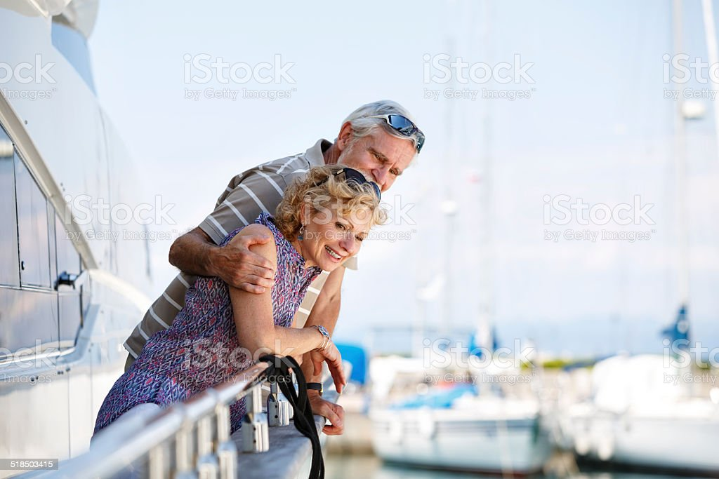 Senior couple relaxing on yacht stock photo