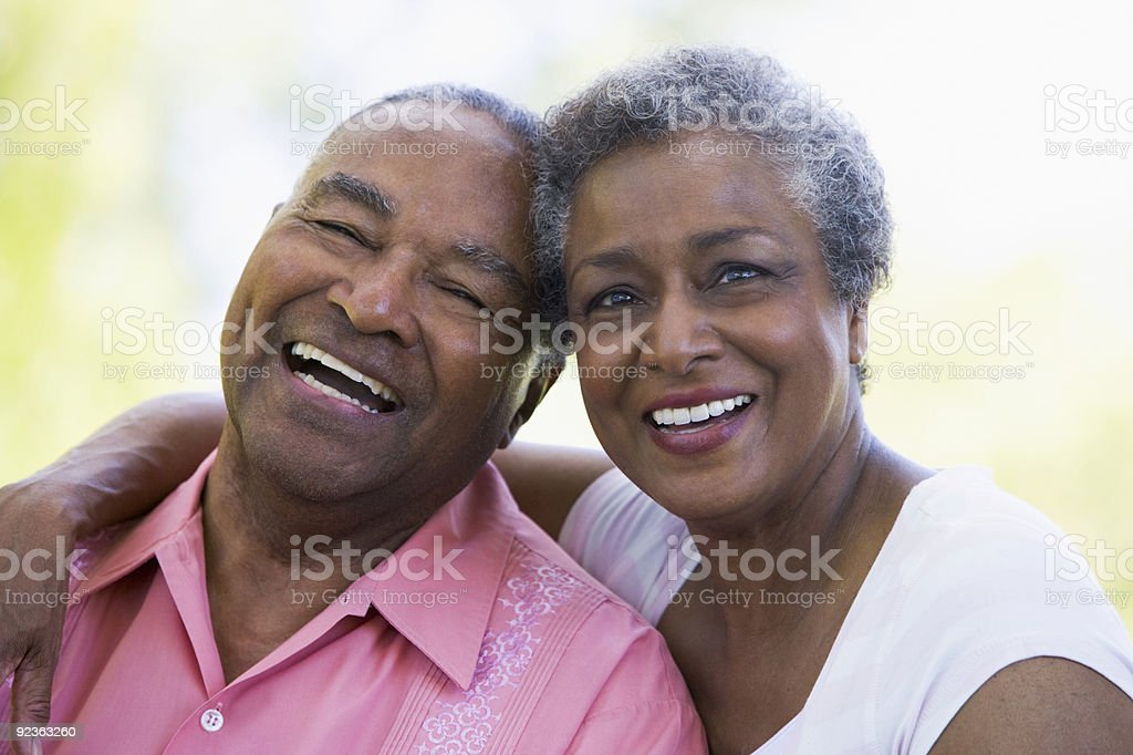 Senior couple relaxing outside stock photo